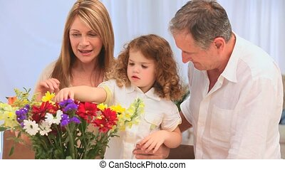 Family making a bunch of flowers