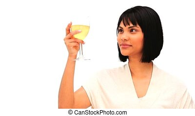 Asian female enjoying a white wine against a white...