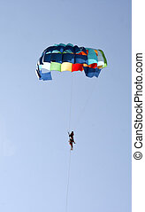 paraglider couple goa india water sport - portrait copy...