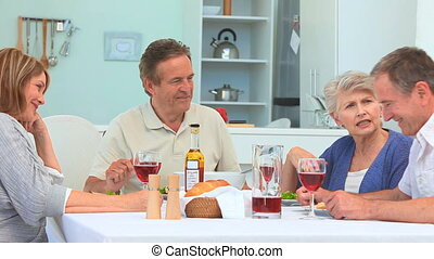 Senior couple having a dinner together in the kitchen