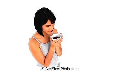 Casual chinese drinking a cup of coffee isolated on a white...