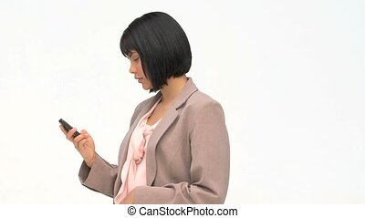 Asian business woman writing an sms on her phone against a...