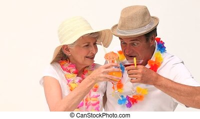 Couple enjoying their cocktails isolated on a white...