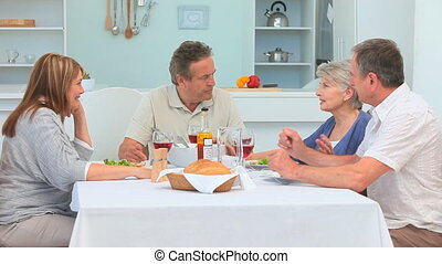 Mature couples having lunch together in the dining room