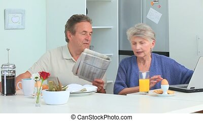 Senior couple taking the breakfast during the morning in the...