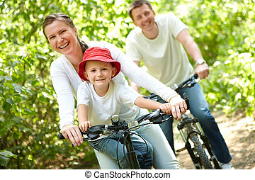 Happy leisure - Portrait of happy woman with son riding a...