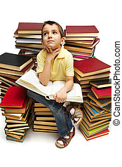 Reading boy - Photo of young boy reading a book while...
