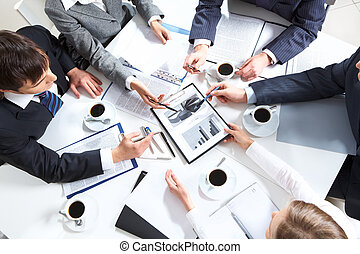 Paperwork - Above view of business team discussing papers