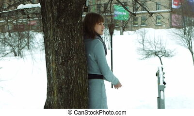 Young female model posing in winter park