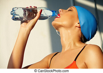 Drinking water - Gorgeous woman with bottle of water in...