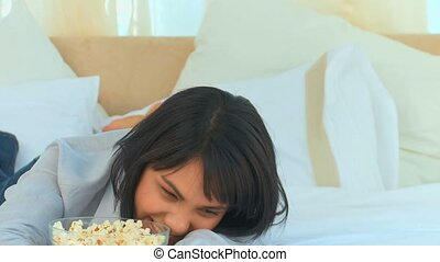 Chinese woman laughing a lot in her bedroom