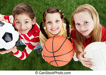 Happy friends - Image of happy friends on the grass with...