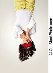Calmness - Upside down view of young girl in mask sleeping...