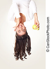 Girl with pear - Upside down view of happy girl with pear in...