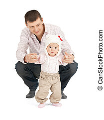 baby making first steps with father help - picture of baby...