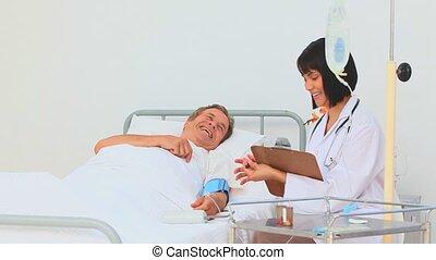 A nurse paying her patient a visit