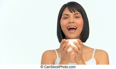 Asian woman enjoying a cup of coffee isolated on a white...