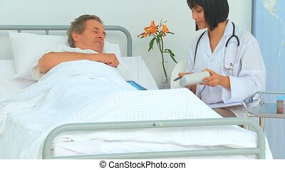A nurse giving results to her patient at the hospital