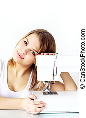 girl with sewing machine on light background