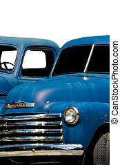 Blue Pick Up Truck - The front grill, headlights and...