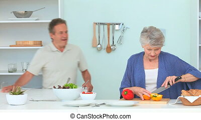Cute mature couple preparing the dinner