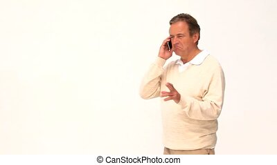 Casual elderly man speaking on the phone isolated on a white...