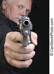 Killer - Old man aiming an automatic pistol at his victim