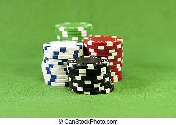 poker chips on green carpet