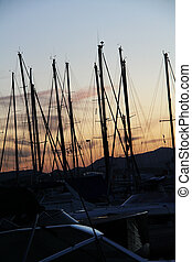 sailing boats - harbour of saint tropez in france at night