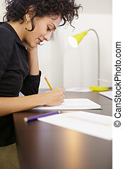 Woman working with sketches in fashion design studio - Young...