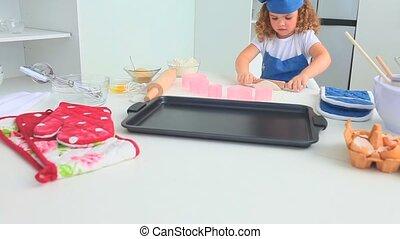 Cute little girl baking alone