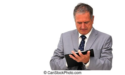 Elderly businessman taking notes isolated on a white...