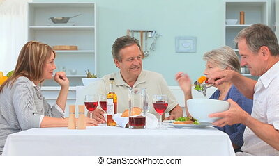 Couples of friends having a lunch in the dinning room