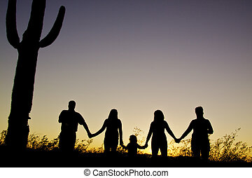 Happy Arizona Family Silhouette - a happy family silhouetted...