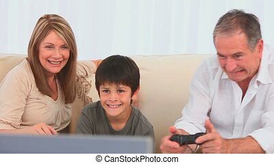 Family playing to video games in the living room