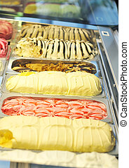 Ice cream parlor. Nine ice cream of different colors....