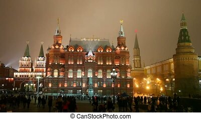 people walking on night red square, moscow, russia