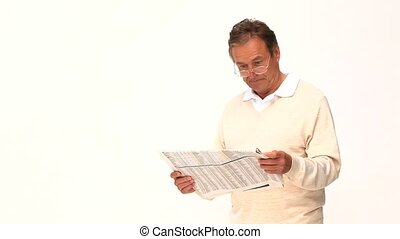 A man reading a newspaper isolated on a white background