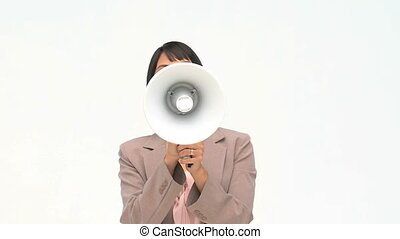 Chinese business woman shouting through a loudspeaker...
