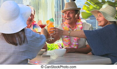Friends celebrating with cocktails in vacation