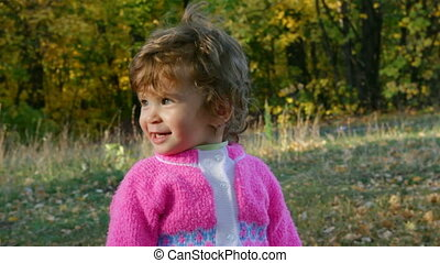 baby girl in autumn park