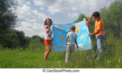 man and woman rolling up political map and giving to boy in...