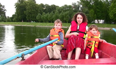 mother with children on boat 3 - Mother with children on...