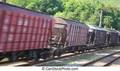 freight train of shipping containers, view from moving train