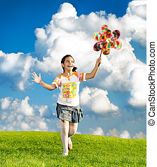 Fantastic scene of happy little girl running and playing...