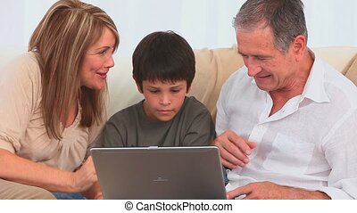 Family playing a game on the laptop
