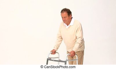 Retired man using a walker isolated on a white background