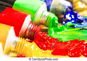 Multicolored tubes of paint. Several colors. shallow...