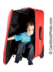 child hiding in suitcase and peeking out