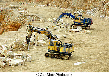Rock Crusher and digger in quarry